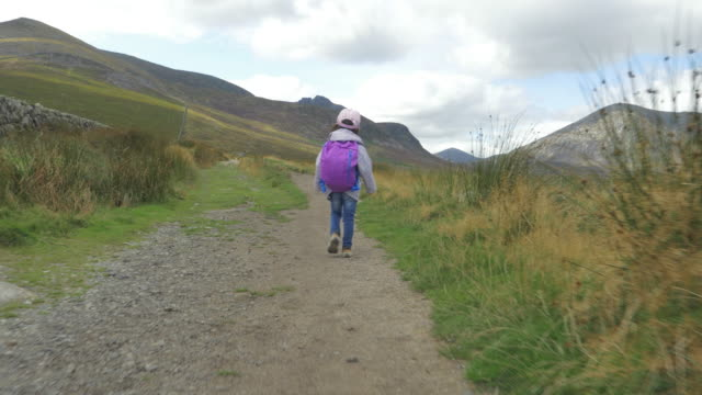 toddler girl hiking in countryside,Northern Ireland video