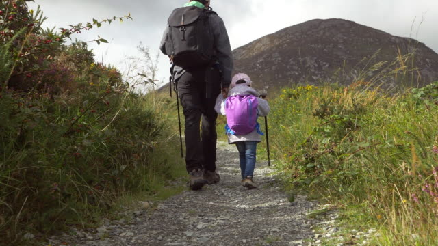 toddler girl hiking with dad  in countryside,Northern Ireland video