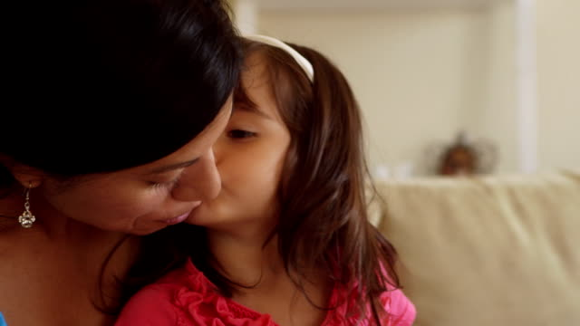 Toddler Girl Kisses Mother On Cheek While on Lap video