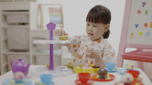 toddler girl  pretend play tea party for homeschooling