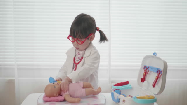 toddler girl pretend playing doctor looking after patient video