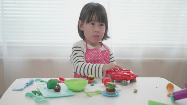 toddler girl pretend playing food preparing toy at home video