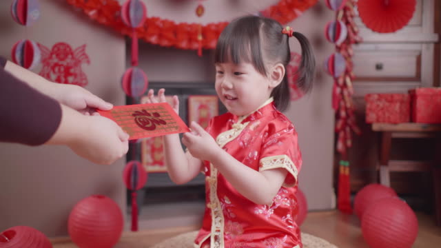 toddler girl with traditional dressing up celebrate Chinese new year video
