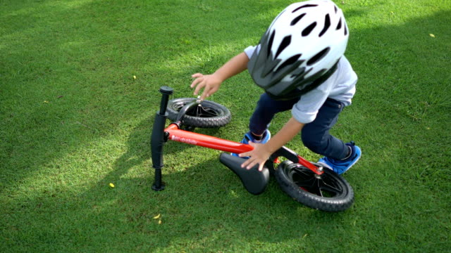 Toddler grab a balance bike and ride. video