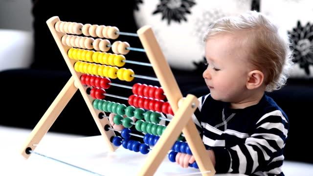 toddler having fun with abacus - abakus bildbanksvideor och videomaterial från bakom kulisserna