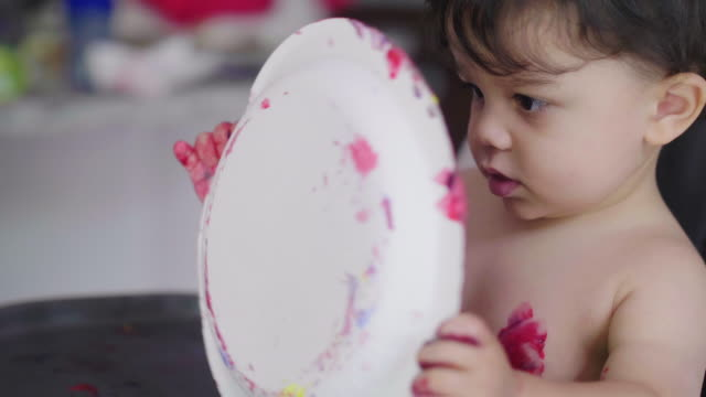 toddler playing with hand paints and plate side - imperfection stock videos & royalty-free footage