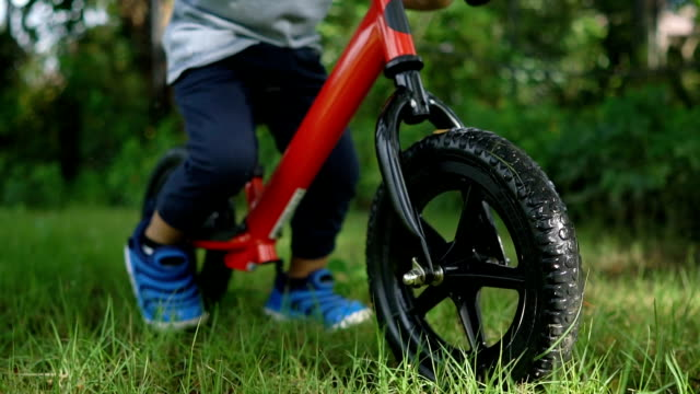 SLO MO Toddler riding balance bike. video