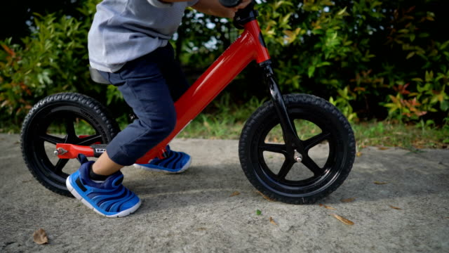 Toddler riding balance bike. video