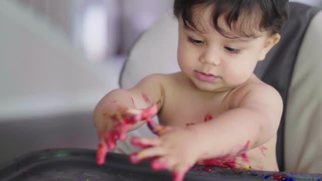 toddler smiles and gets paint on chest - imperfection stock videos & royalty-free footage