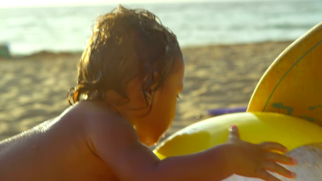 Toddler tries to grab a beach ball video