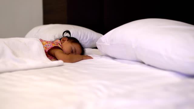 Todler girl (2-3) sleeping on bed video