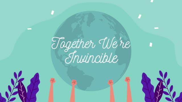 一緒に私たちは手を上げて無敵のメッセージレタリングキャンペーンです - 拳 イラスト点の映像素材/bロール