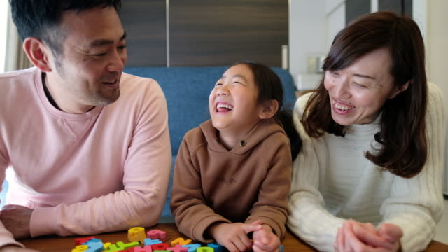 Togetherness of family at home Togetherness of family at home childhood stock videos & royalty-free footage