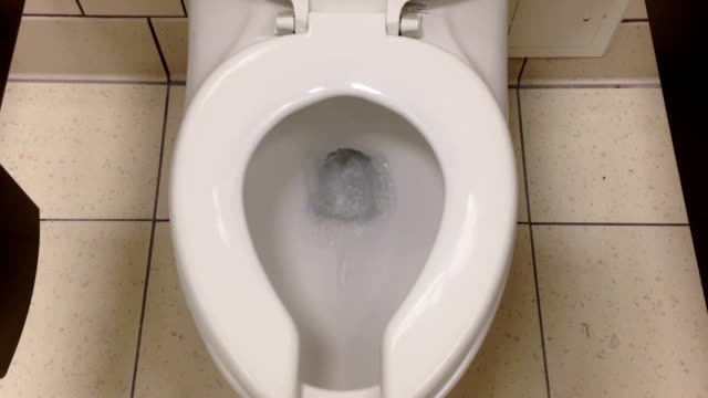 Toilet flushed top down view video