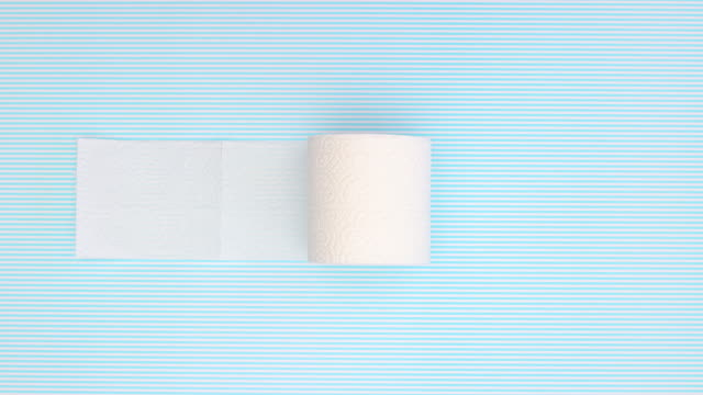 toilet paper rolling on blue background - stop motion - icon set healthy video stock e b–roll