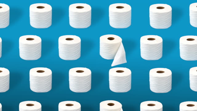 Toilet paper rolls on a blue background