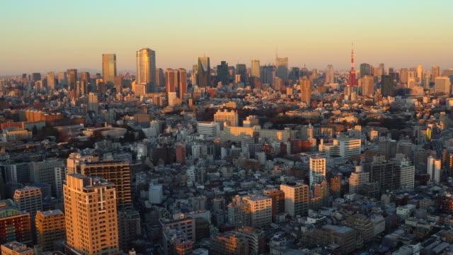 stockvideo's en b-roll-footage met tokyo cityscape bij zonsondergang - financieel district