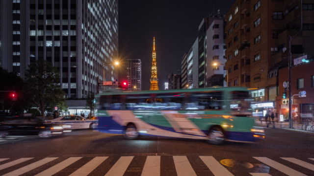 Tokyo tower iconic landmark of Japan with Tokyo transportation in evening car light Tokyo tower iconic landmark of Japan with Tokyo transportation in evening car light tokyo tower stock videos & royalty-free footage