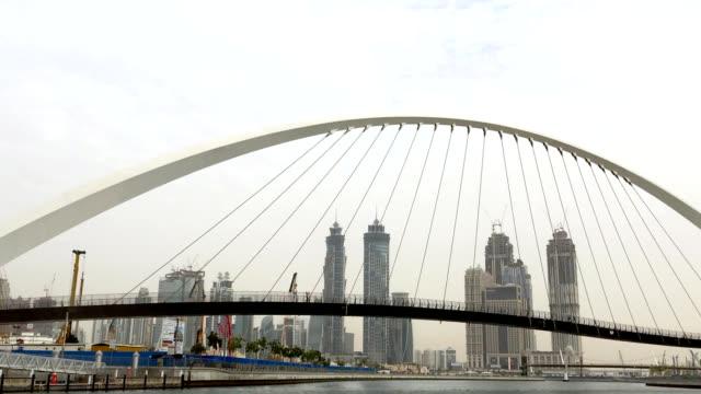 Tolerance bridge and city skyline in Dubai Tolerance bridge and city skyline in Dubai, shot from boat deck dubai architecture stock videos & royalty-free footage
