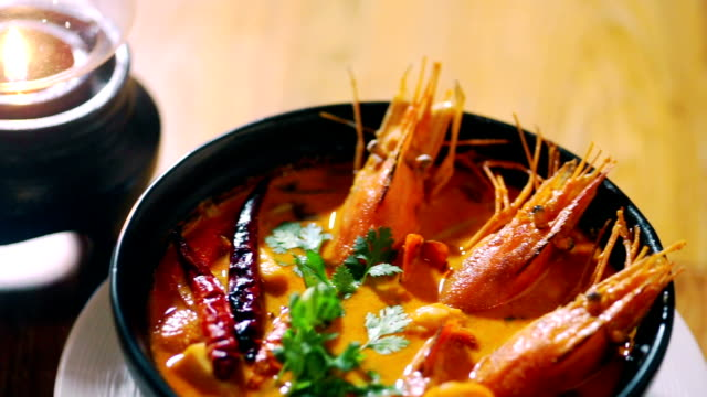 tom yum goong in a black bowl, seafood soup. - seafood stock videos and b-roll footage