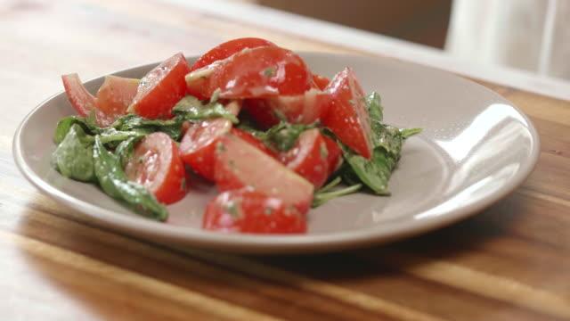 tomato basil salad with sliced mozzarella cheese