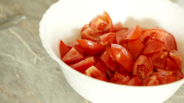 Tomato salad HD video of Simple tomato salad is being seasoned with sea salt and (on my word of honor) premium quality olive oil; closeup tomato salad stock videos & royalty-free footage