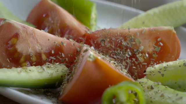 Tomato,cucumber and green pepper HD 1920x1080 / 25p / Photo-JPEG / Slow motion tomato salad stock videos & royalty-free footage
