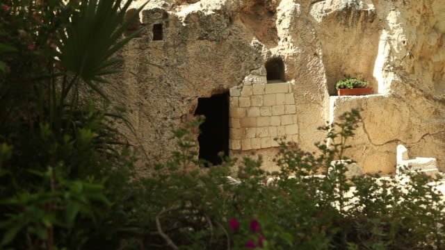 HD Tomb of Jesus Christ in Jerusalem The empty tomb where Jesus Christ was laid in a garden at Easter ornamental garden stock videos & royalty-free footage