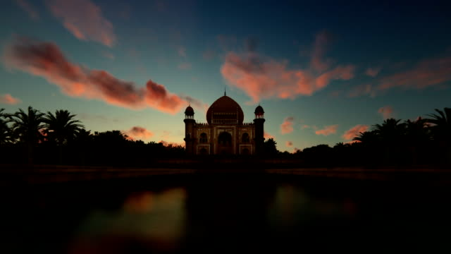 Tomb of Safdarjung, Delhi, India, against timelapse sunrise, zoom in