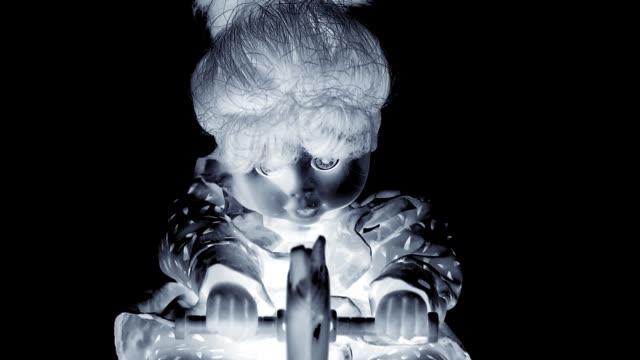 toned monochrome spooky doll