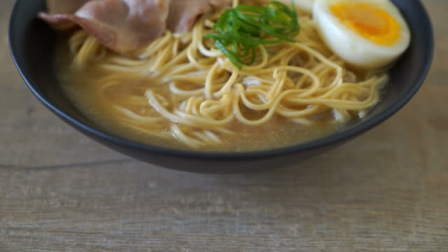 tonkotsu ramen noodles with pork and egg tonkotsu ramen noodles with pork and egg boiled stock videos & royalty-free footage