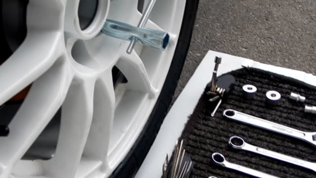 Tools kit for car disk mounting near car wheel video