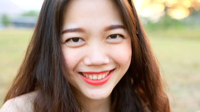 toothy smiling face of asian woman happiness emotion video