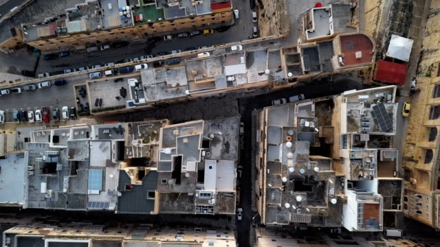 Top aerial view of roofs in old town Valletta, Malta. Roofs of Valletta, Malta malta stock videos & royalty-free footage
