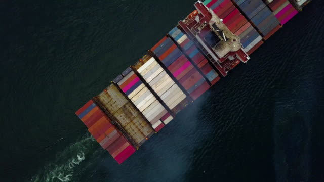 Top down Aerial view, Cargo vessel sail to the sea. Bird's eye view shot.