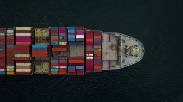 top down aerial view, cargo vessel sail to the sea with peaceful wave. - nave mercantile video stock e b–roll
