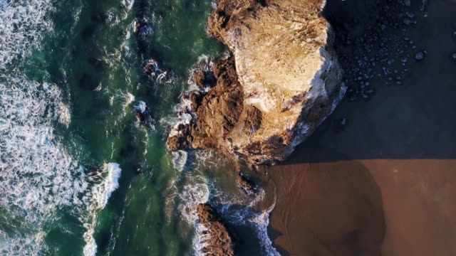 top down aerial view of dramatic oregon coastline - rock formations stock videos & royalty-free footage