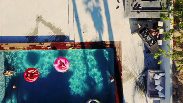 Top Down Drone Shot of DJ Playing at Pool Party video