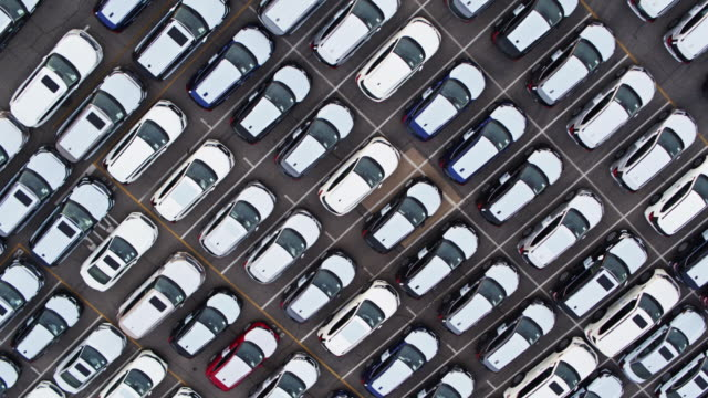 Top Down Drone Shot of Lot Full of New Cars video