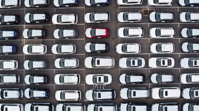 Top Down Drone Shot of New Cars in Yard