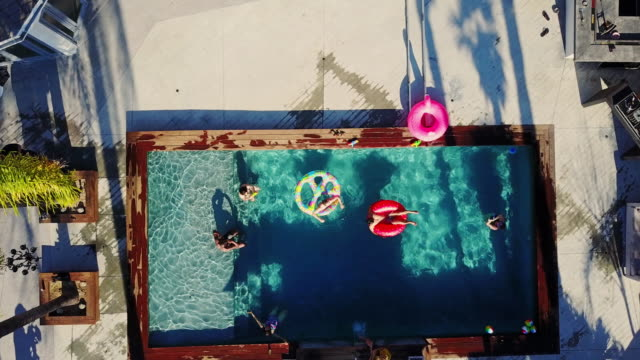 Top Down Drone Shot of People at Backyard Pool Party video