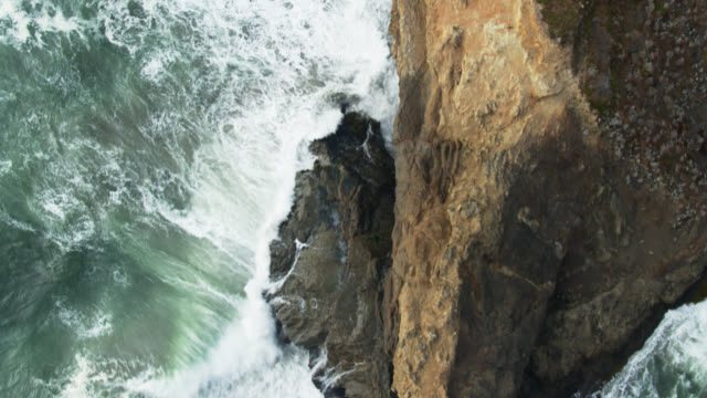 Top Down Drone Shot with Upward Tilt of Waves Swirling Around Rocks off the Lost Coast, California
