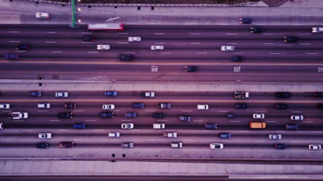 top down shot of freeway traffic - fast - traffic filmów i materiałów b-roll
