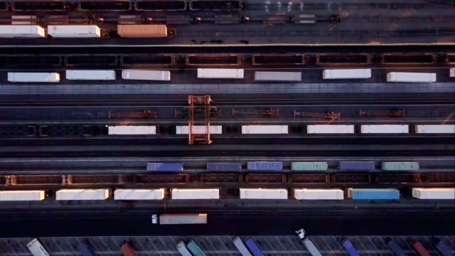 Top Down View Of Cargo Container Being Loaded Onto Freight Train видео