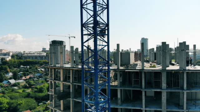 Top floor of the high-rise building under construction Top floor of the high-rise building under construction. 4K construction machinery stock videos & royalty-free footage