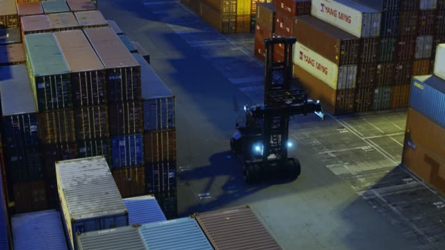 Top Handler Among Shipping Container Stacks - Drone Shot video