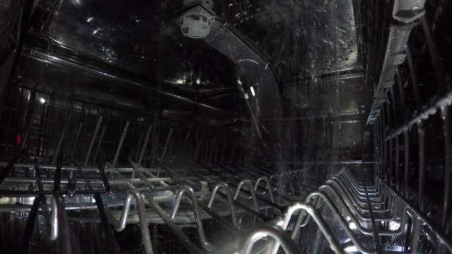 Top Rack of dishwasher as cycle starts Cycle Starting seen from top rack of dishwasher dishwasher stock videos & royalty-free footage