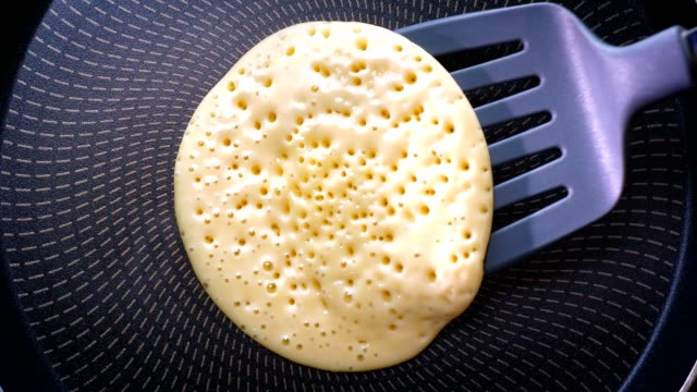 top shot, delicious pancake is fried on the pan from both sides, fresh and tasty - pancake video stock e b–roll