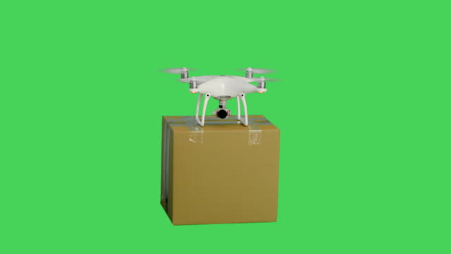 Top Shot of a Drone Flying Delivering Mail Cardboard Box. Background is Green Screen. Top Shot of a Drone Flying Delivering Mail Cardboard Box. Background is Green Screen. Shot on RED Cinema Camera 4K (UHD). propeller stock videos & royalty-free footage