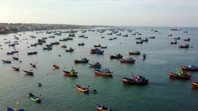 top view, aerial view fishing harbor market from a drone - łowić ryby filmów i materiałów b-roll